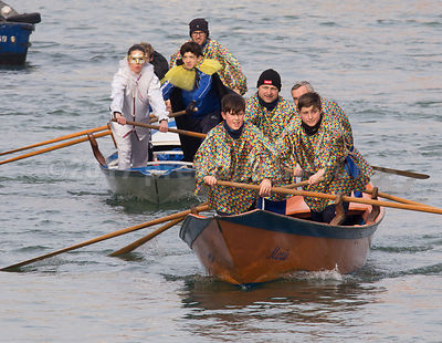 Young People rowing in the Venice Carnival Water Parade  on the Rio di Cannaregio Canal