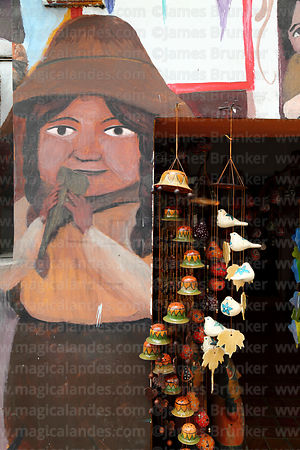 Wind chimes and detail of mural on wall of handicraft shop, Miraflores, Lima, Peru
