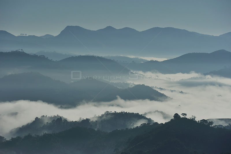 Aerial view of Sierra of Mantiqueira mountains in the early morning with mist in the valleys, from Visconde de Maua¡ locality, Resende, Rio de Janeiro State, Brazil, June 2011