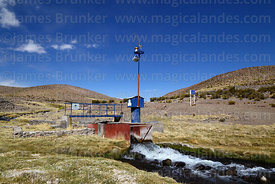 Solar powered gauge measuring flow of River Guallatiri, Guallatiri volcano in background, Las Vicuñas National Reserve, Region XV, Chile