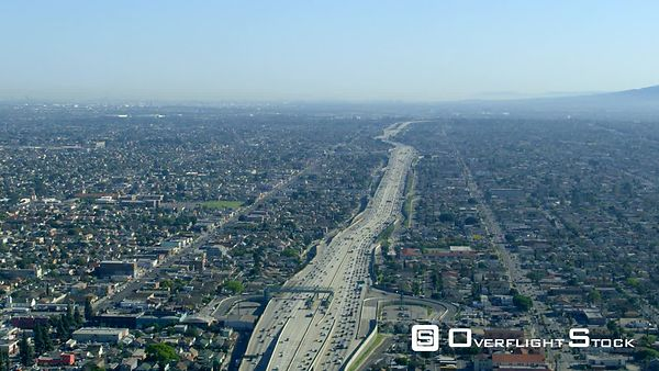 Red Epic Video WS of I110, Harbor Freeway, looking south towards Long Beach and San Pedro Los Angeles California USA. Harbor Freeway, I110 is one of the two main arteries for road freight from the ports of Los Angeles and Long Beach