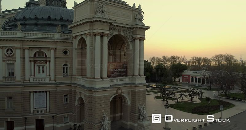 Aerial camera flies slowly back from the Odessa Opera Theatre at sunrise Ukraine