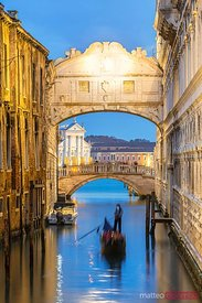 Bridge of sighs at dusk with gondola, Venice, Italy