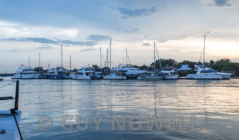 2017 Raja Muda Selangor International Regatta. Wandering pontoon, part II. The whole shemozzle, with boats attached, fetched up just downstream of the Royal Selangor Yacht Club.