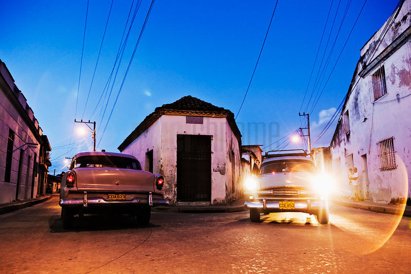 Vintage Cars in the Street at Dusk.