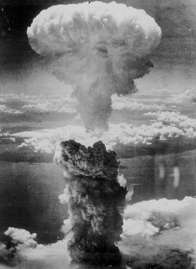 JAPAN Nagasaki -- 08 Aug 1945 -- Out with a bang...A dense column of smoke rises more than 60,000 feet into the air over the Japanese port of Nagasaki,