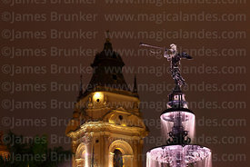 Close up of fountain and tower of cathedral at night, Plaza de Armas, Lima, Peru