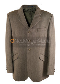 Stock image - Mens equestrian tweed jacket on white background