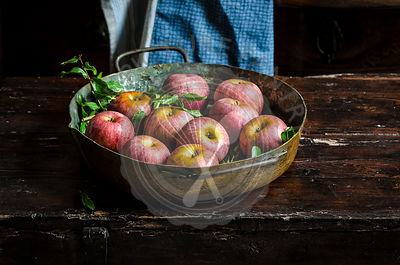 Apples on a rustic kitchen table