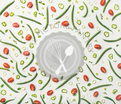 Flat-lay of fresh vegetable slices over white wooden background, top view, copy space