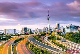 Auckland city  and highways illuminated at dusk, New Zealand