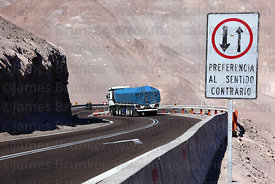 Truck waiting after Give Way to Oncoming Traffic sign before hairpin bend on Ruta / Highway 11, Region XV , Chile