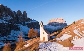 Aerial view of small church at sunrise, Dolomites