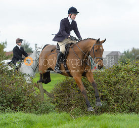 Willa Newton jumping a hedge near the meet in Long Clawson