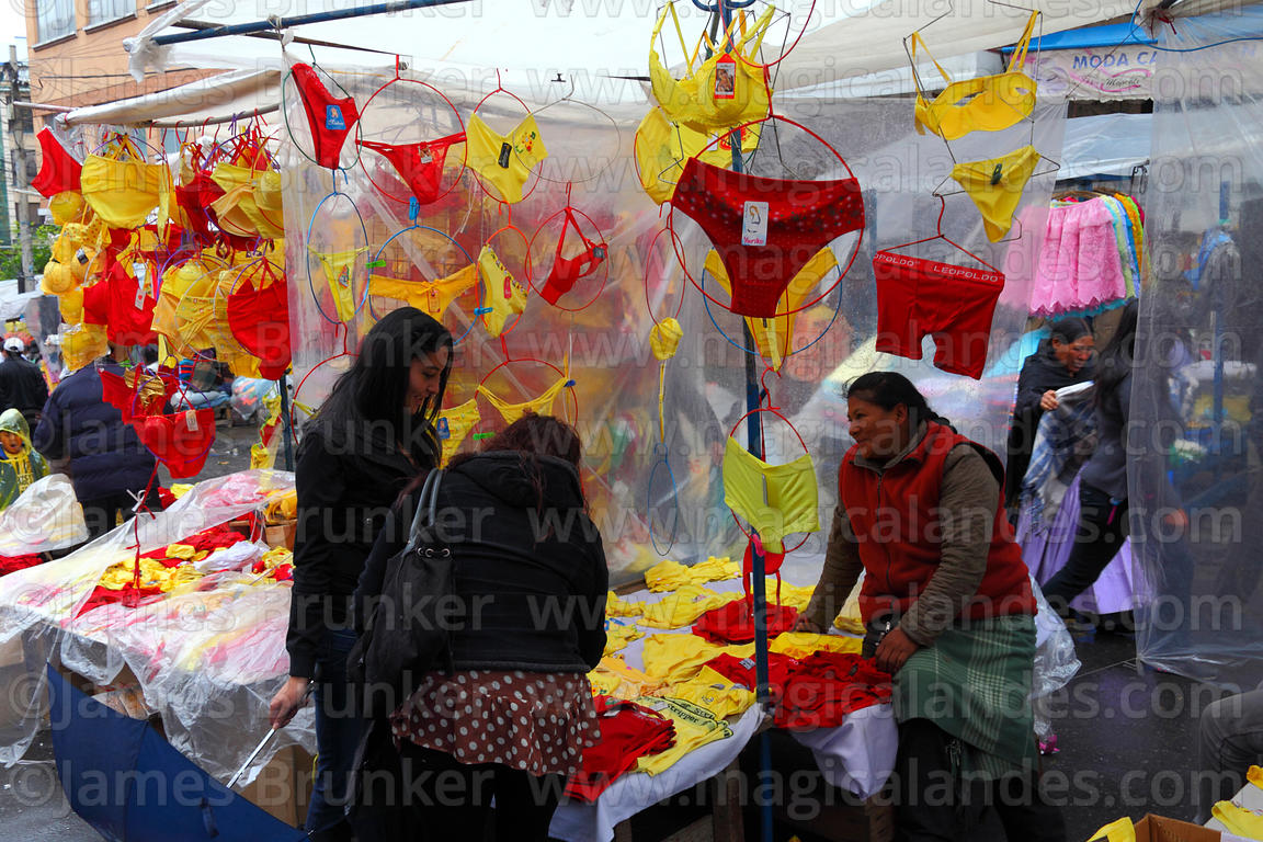 Women shopping for red and yellow underwear on New Year's Eve, La Paz, Bolivia