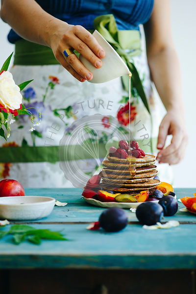 Pancakes on a blue wooden table