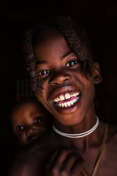 Portrait of a Young Himba Girl and Baby