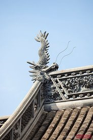 Dragon on roof of old house in Shanghai, China