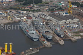 Birkenhead aerial photograph of Royal Navy ships under going repair and refit in Cammell Laird Shipyards