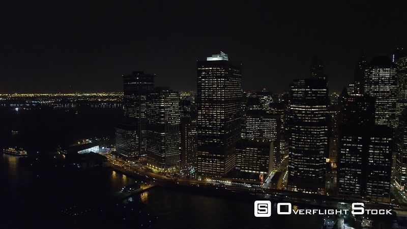 Flying above the East River at night, looking west to Financial District.