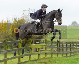 Meghan Healy jumping a fence at Stone Lodge Farm