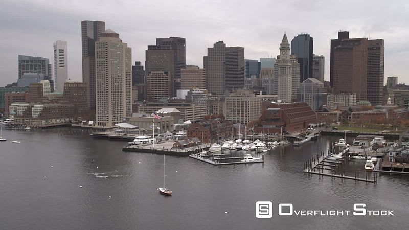 Flying along Boston Harbor past Boston skyline toward downtown.