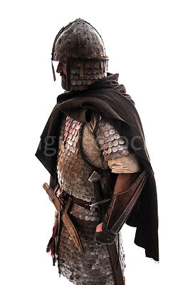 A semi-silhouette of a wealthy Viking in armour and a cape – shot from eye level.