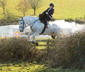 Chloe Edgar jumping a hedge at Bleak House