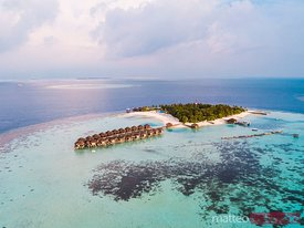Aerial view of a tropical island at sunset, Maldives
