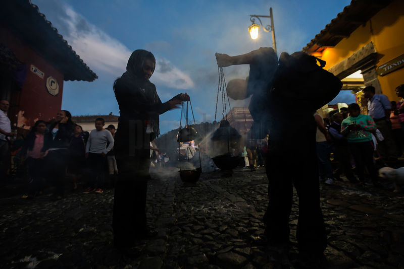 Man Lighting an Incense Carrier