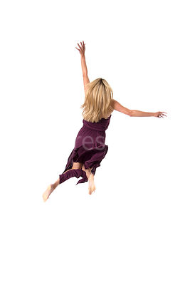 A blonde woman in a dress jumping or falling.