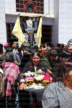 Aymara woman leaving church with her skulls after mass, Ñatitas festival, La Paz, Bolivia