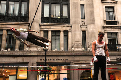 Man Flying Round Stage in London Street