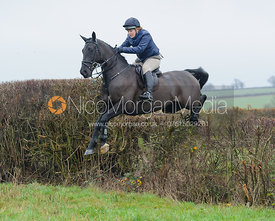 Milly Mitchell jumping a hedge behind Waterloo Lodge