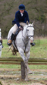 Cottesmore Hunt followers jump a hunt jump