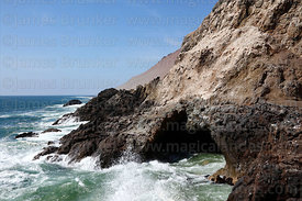Cave and rocky coastline on Cuevas de Anzota trail near Arica, Region XV, Chile