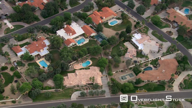 Mid-level flight over upscale Scottsdale neighborhood.