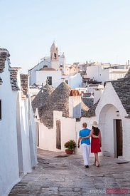 Couple visiting the Trulli, Alberobello, Apulia, Italy