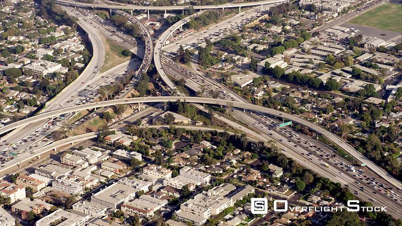 Aerial View Of The I405 And I10 Junction (One Of The Original Spaghetti Junctions), Then Eastbound Along I10, RED R3D 4k California
