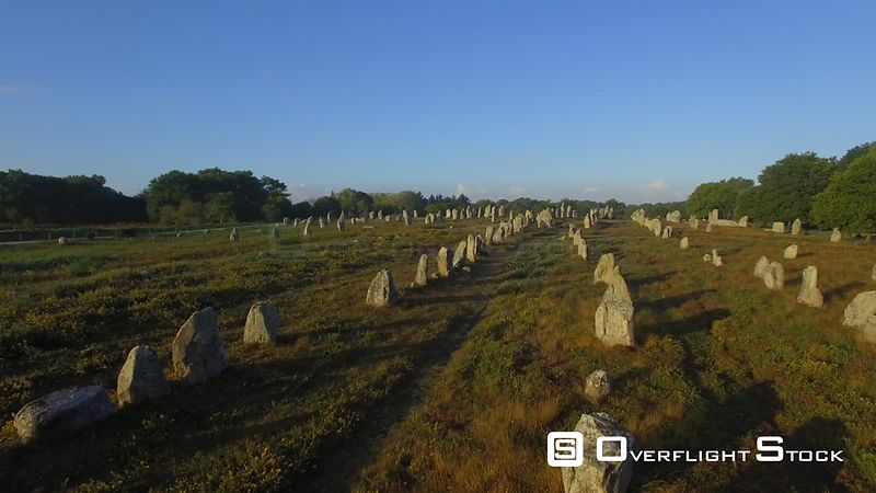 Aerial view of the Alignments of Kermario at sunrise, filmed by drone, Carnac, Morbihan, Brittany, France