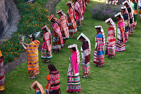 Ñustas / Virgins of the Sun below Coricancha / Sun Temple at start of Inti Raymi festival, Cusco, Peru