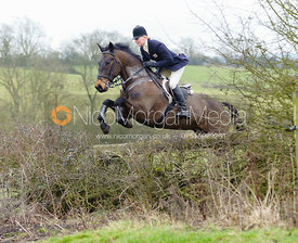 Gaby Cooke jumping hedges near Bleak House, Knossington
