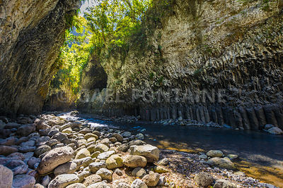 Hiking in a canyon of Bras de La Plain at Reunion Island