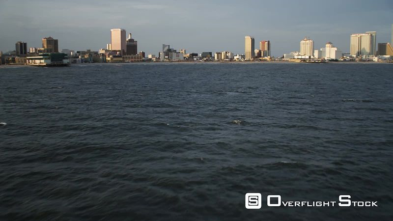 Low over the water, approaching Atlantic City, New Jersey, and flying along the waterfront. Shot in November