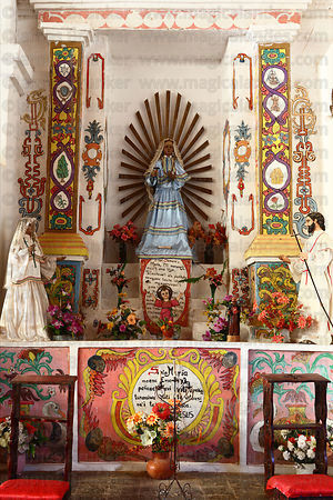 Figure of Virgin Mary on side altar inside Jesuit Mission church, San Ignacio de Moxos, Beni, Bolivia