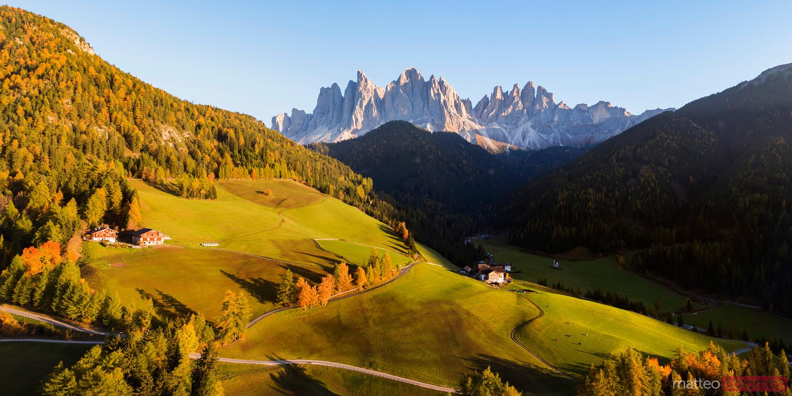 Aerial panoramic of Funes valley in autumn, Dolomites, Italy