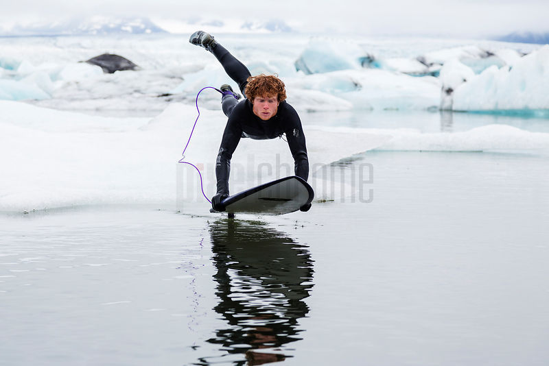 Surfer Launching Himself into Glaciar Lagoon