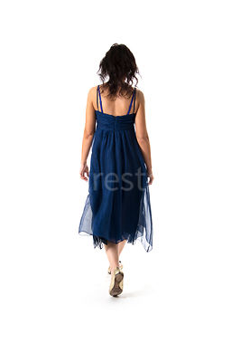 A woman walking away in a summer dress – shot from mid level.