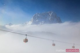 Landscape: mountain valley and peak in winter with cable car, Dolomites, Italy