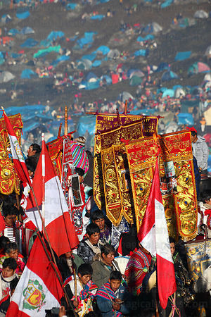 Dance groups parading with banners during Qoyllur Riti festival, Peru
